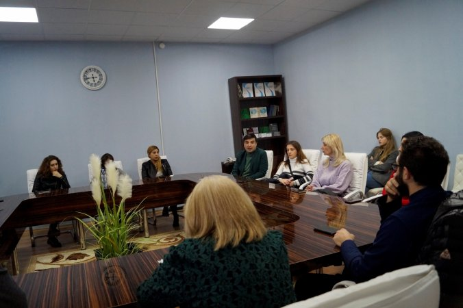 A Meeting at the University Millennium